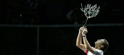 1154242_ferrer-of-spain-celebrates-with-trophy-after-winning-his-final-men-s-singles-match-against-jerzy-janowicz-of-poland-at-the-paris-masters-tennis-tournament-in-paris