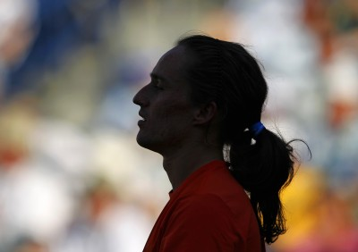Dolgopolov reacts after missing a shot to Nadal in Indian Wells